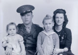 Portrait of family with man in military uniform
